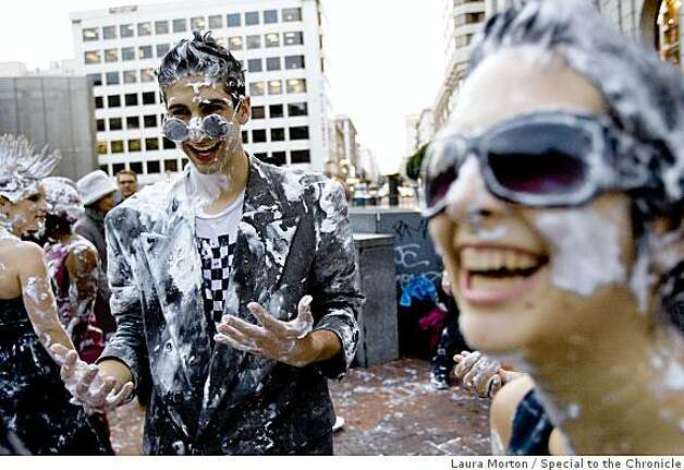 Scott Shoemaker and Julia Tejeda share a laugh in the aftermath of a flash mob pie fight at the Powell and Market cable car turn around in San Francisco, Calif., on Thursday, March 5, 2008. Photo: Laura Morton, Special To The Chronicle