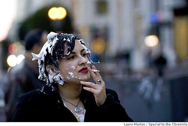 Nicole Schach enjoys a smoke in the aftermath of a flash mob pie fight at the Powell and Market cable car turn around in San Francisco, Calif., on Thursday, March 5, 2008. Photo: Laura Morton, Special To The Chronicle