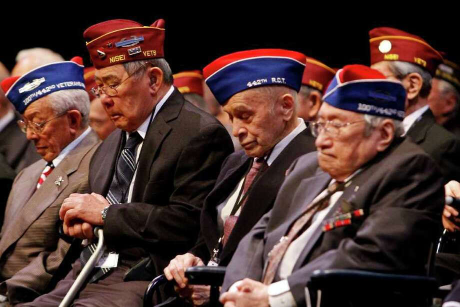 Nisei Veterans at the Seattle Regional Congressional Gold Medal Celebration at Meany Hall on the University of Washington campus in Seattle on Saturday, Jan. 14, 2012. The ceremony was held in honor of the Japanese American Nisei Veterans of the 100th Infantry Battalion who fought in World War II. The medal is the highest civilian award in the nation. Despite the fact that people of Japanese ancestry were being discriminated against at that time in America, soldiers in this Battalion chose  to serve, suffering tremendous casualties during the war. They were not fully recognized for their valor until recently. Photo: JOE DYER / SEATTLEPI.COM