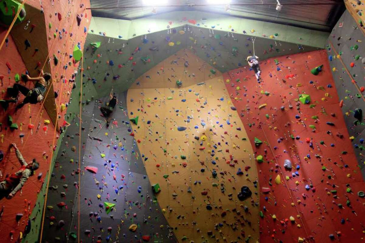 Dozens of climbers scaled the new walls at the grand opening party of Vertical World 4.0 in Seattle on Saturday, Jan. 14, 2012. The party had over 100 participants, live music, and free beverages and food.