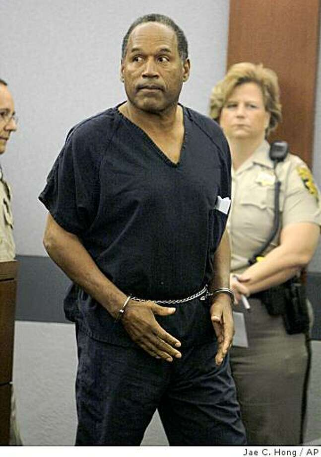 .J. Simpson appears handcuffed in a Clark County Justice courtroom for his arraignment in Las Vegas, Wednesday, Sept. 19, 2007. (AP Photo/Jae C. Hong, Pool) Photo: Jae C. Hong, AP