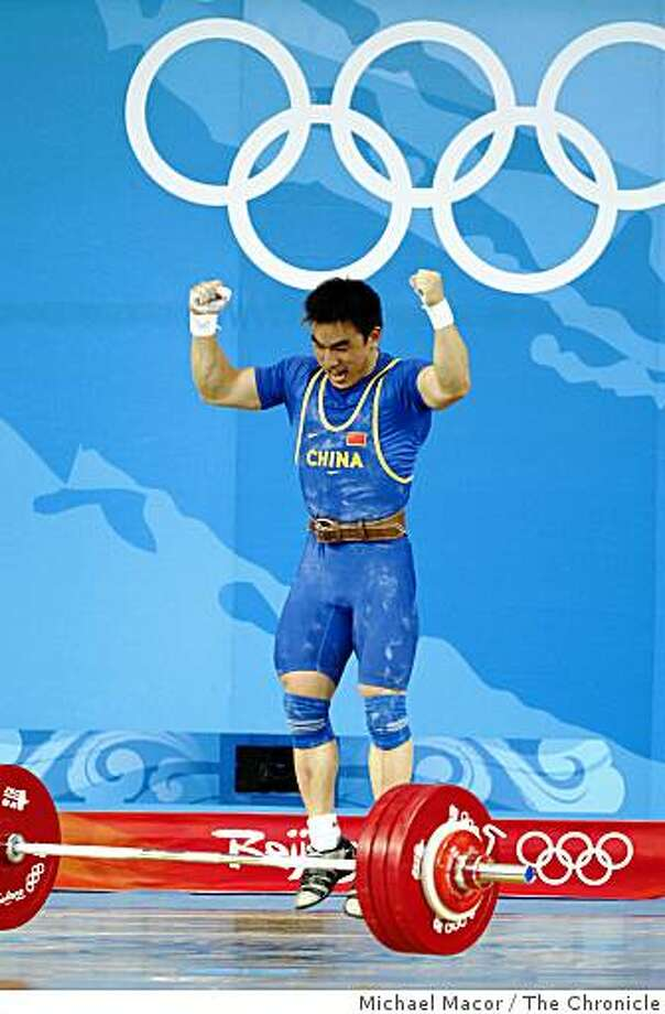 Hui Liao of Chine celebrates his gold medal win in the competiton after lifting 418 lbs. in the clean and jerk,  during the 2008 Olympic Games, Tuesday Aug. 12, 2008 in Beijing, China. Photo: Michael Macor, The Chronicle