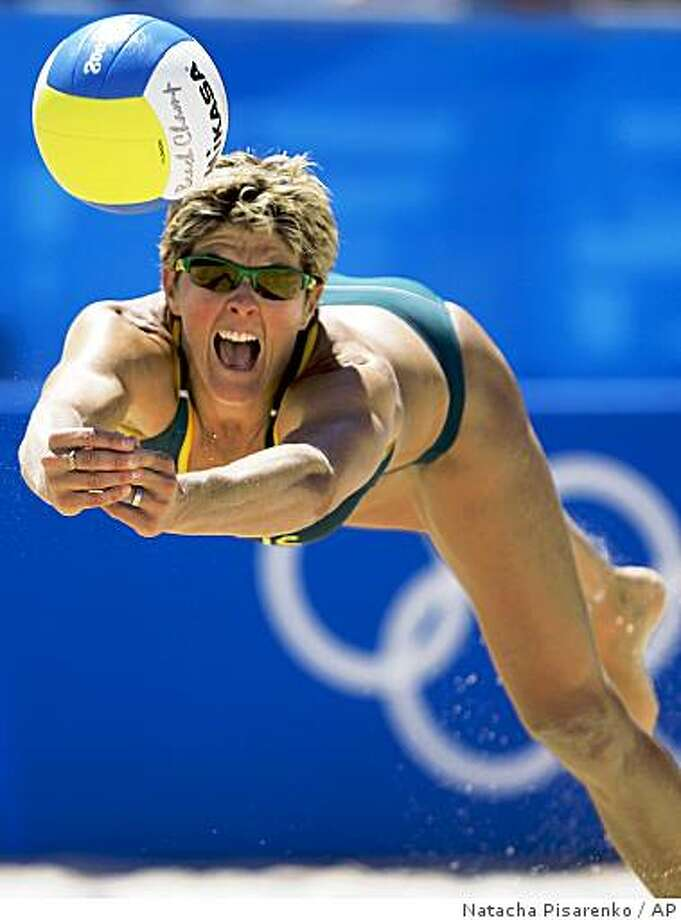 Australia's Natalie Cook dives for the ball during a beach volleyball match against Greece at the Chaoyang Park Beach Volleyball Ground at the Beijing 2008 Olympics in Beijing, Friday, Aug. 15, 2008. Australia won 22-20, 19-21, 15-12. Photo: Natacha Pisarenko, AP