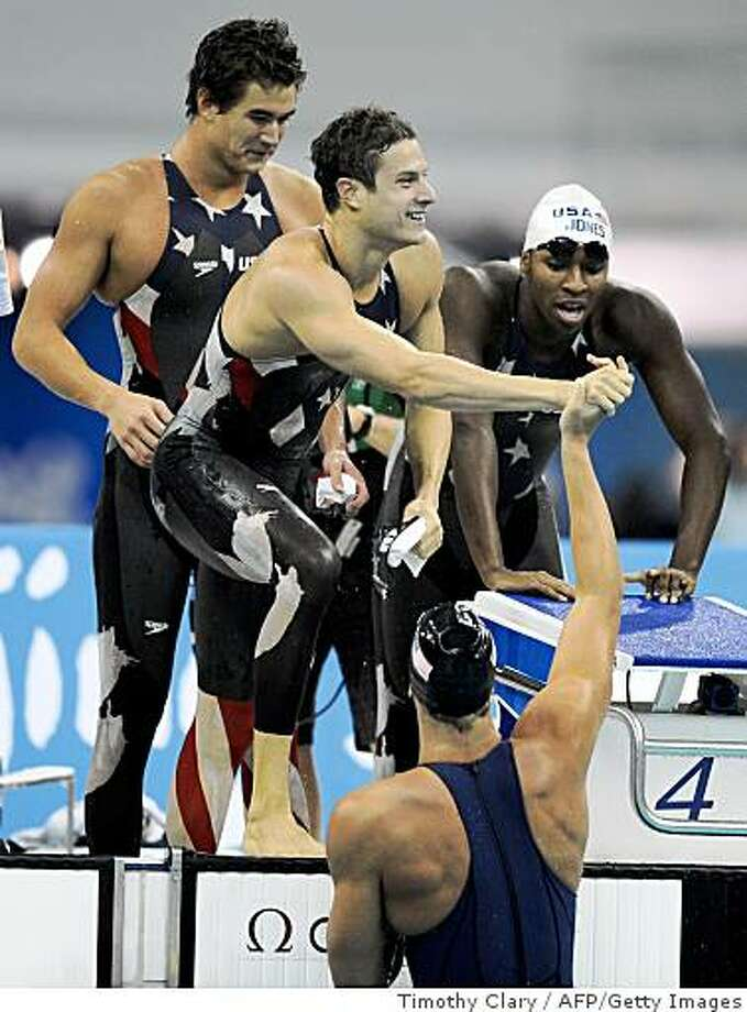 US swimmers Ben Wildman-Tobriner (C), Cullen Jones (R), Nathan Adrian (L) and Matt Grevers (lower) compete during the men's 4x100m freestyle relay swimming heat at the National Aquatics Center at the 2008 Beijing Olympic Games on August 10, 2008 in Beijing. The US team swam a time of 3:12.23, a new world record. Photo: Timothy Clary, AFP/Getty Images