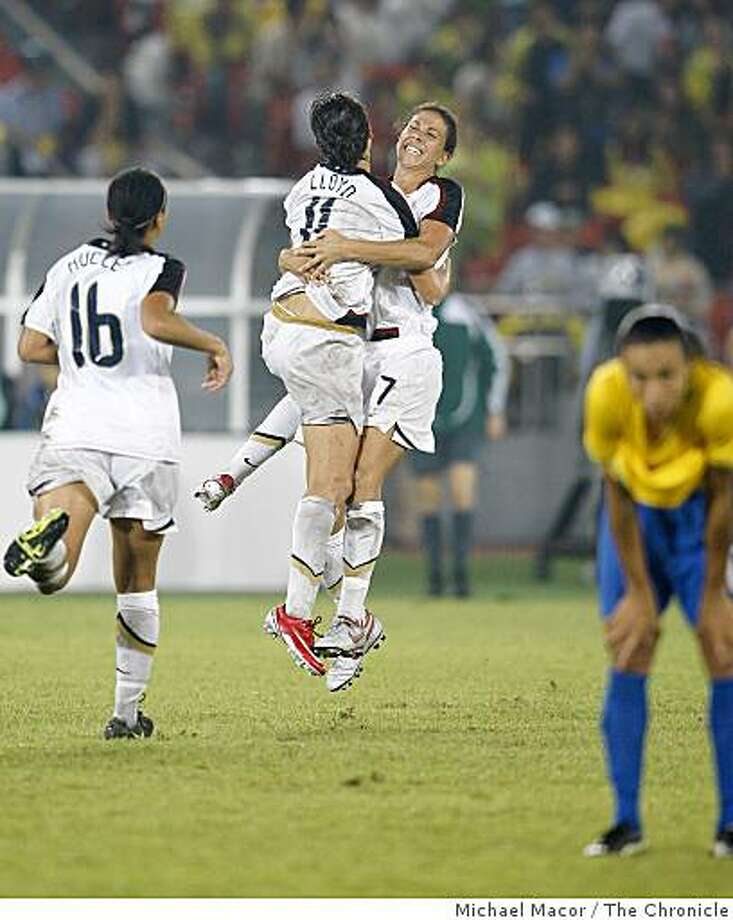 The only goal of the game was scored by USA player Carli Lloyd (11) in the 2nd half, teammates Angelica Hucles (16) and Shannon Boxx (7) celebrate the team's gold medal win at the 2008 Olympics in Beijing, China, Thursday  Aug. 21, 2008. Photo: Michael Macor, The Chronicle