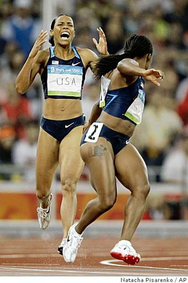 United States' Torri Edwards, left, and Lauryn Williams drop the baton in a women's 4x100-meter relay heat during the athletics competitions in the National Stadium  at the Beijing 2008 Olympics in Beijing, Thursday, Aug. 21, 2008. (AP Photo/Natacha Pisarenko) Photo: Natacha Pisarenko, AP