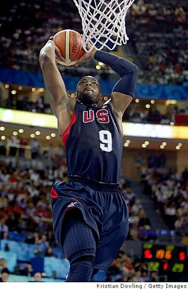 BEIJING - AUGUST 16:  Dwyane Wade #9 of the United States goes up for a dunk while taking on Spain during the group B preliminary basketball game at the Beijing Olympic Basketball Gymnasium on Day 8 of the Beijing 2008 Olympic Games on August 16, 2008 in Beijing, China.  (Photo by Kristian Dowling/Getty Images) Photo: Getty Images