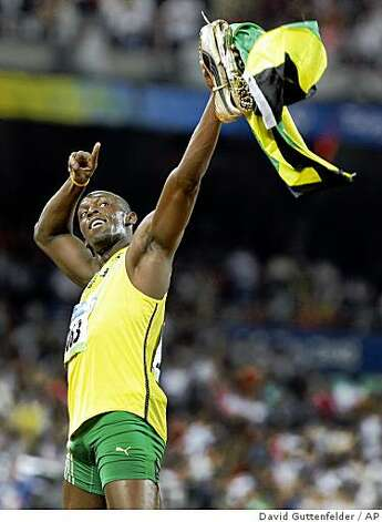 Olympic 100m champion Usain Bolt of Jamaica runs his victory lap in the National Stadium at the Beijing 2008 Olympics in Beijing, Saturday, Aug. 16, 2008. Photo: David Guttenfelder, AP