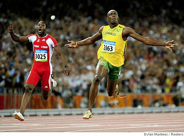 REFILE - CORRECTING WINNING TIMEUsain Bolt of Jamaica (R) runs past Richard Thompson of Trinidad and Tobago to win the men's 100m final of the athletics competition in the National Stadium at the Beijing 2008 Olympic Games August 16, 2008. Bolt won 100 metres gold at the Beijing Olympics in a world record time on Saturday, running 9.69 seconds to claim victory in an exhilarating showdown with his compatriot Asafa Powell.     REUTERS/Dylan Martinez (CHINA) Photo: Dylan Martinez, Reuters