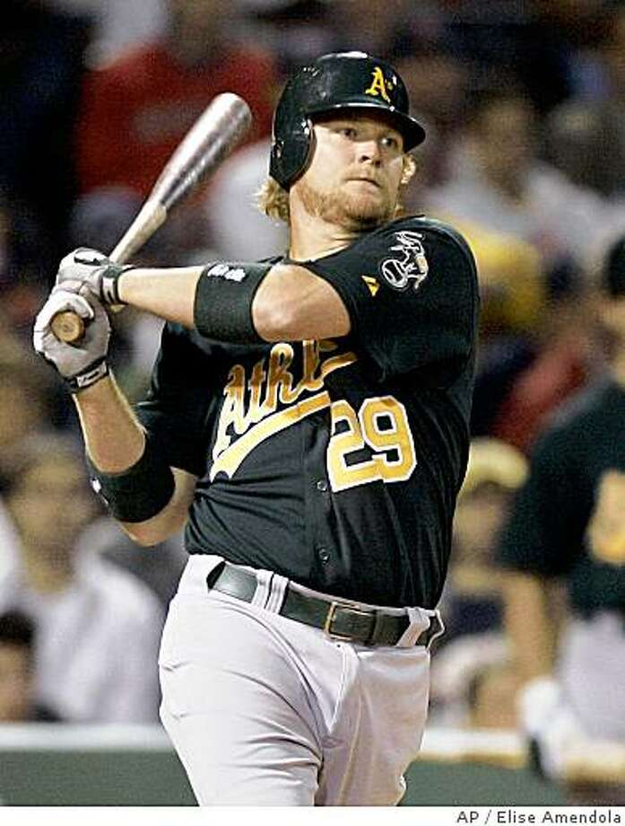 Oakland Athletics' Dan Johnson (29) watches his RBI double scoring Mike Piazza against the Boston Red Sox in the tenth inning of their baseball game at Fenway Park in Boston Tuesday, May 1, 2007. Johnson's hit proved to be the game-winner in their 5-4 victory over the Red Sox. (AP Photo/Elise Amendola) Ran on: 05-02-2007 Dan Johnson doubles to right to drive in Mike Piazza with the eventual game-winning run in the 10th. Ran on: 05-02-2007 Dan Johnson doubles to right to drive in Mike Piazza with the eventual game-winning run in the 10th. Ran on: 05-02-2007 Dan Johnson doubles to right to drive in Mike Piazza with the eventual game-winning run in the 10th. Ran on: 07-29-2007 A's first baseman Dan Johnson has piqued the interest of some traders, including the Yankees, but his inconsistent defense is considered a liability. Ran on: 09-21-2007 Dan Johnson is giving way to Daric Barton at first base, leaving his future with the A's in doubt. Ran on: 09-21-2007 Ran on: 09-21-2007 Photo: Elise Amendola, AP