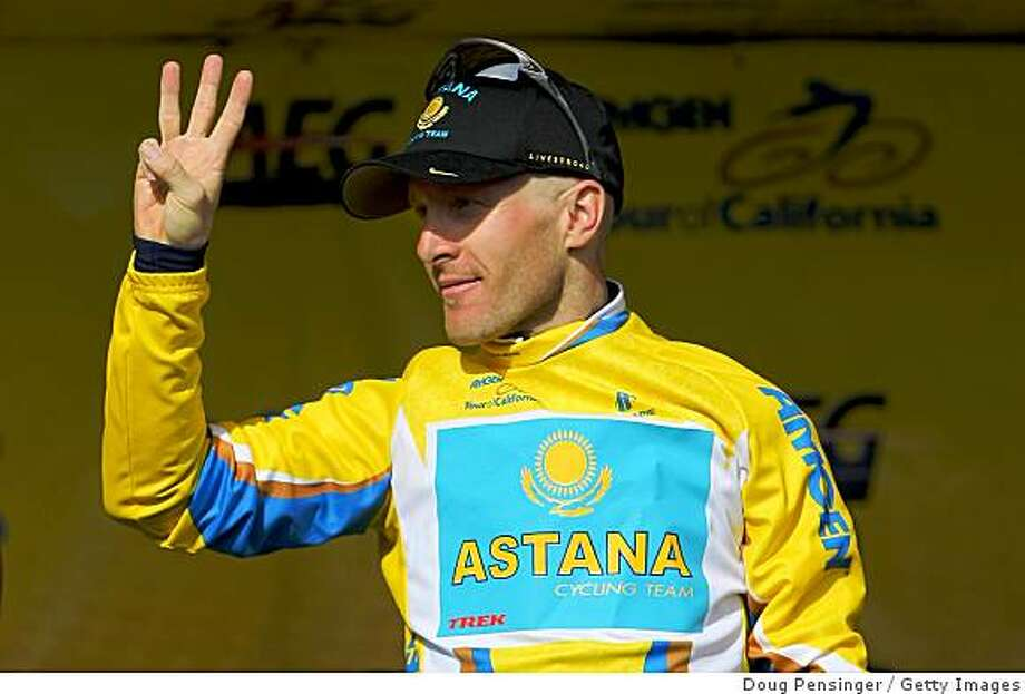 Levi Leipheimer of the USA and riding for Astana gestures with the number three after he won his third time trial in as many years in Solvang and is enroute to winning his third consecutive Tour of California as he takes the podium following the Individual Time Trial on Stage 6 of the AMGEN Tour of California on February 20, 2009 in Solvang, California. Photo: Doug Pensinger, Getty Images