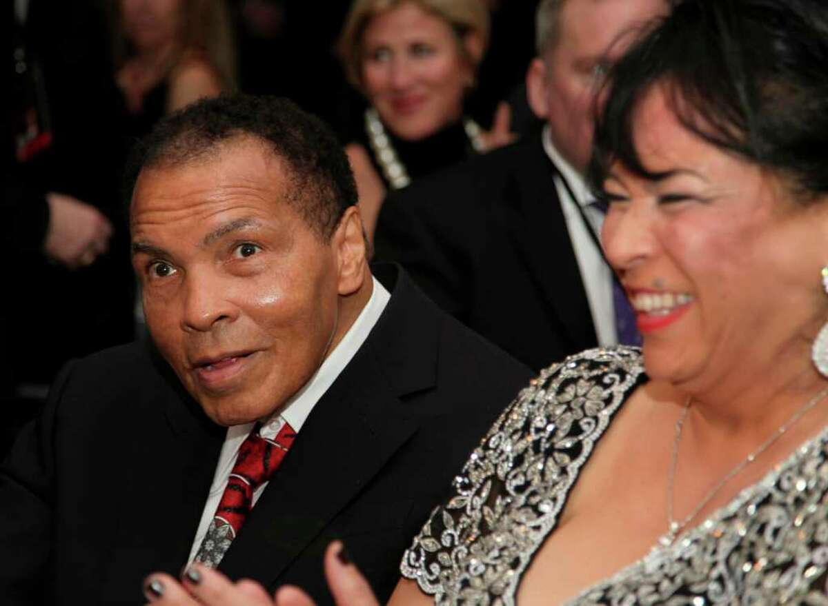 Muhammad Ali , left, celebrates his 70th birthday next to his sister-in-law, Marilyn Williams, at a fund raiser for the Muhammad Ali Center in his hometown of Louisville, Ky., on Saturday, Jan. 14, 2012. Ali turns 70 Tuesday.