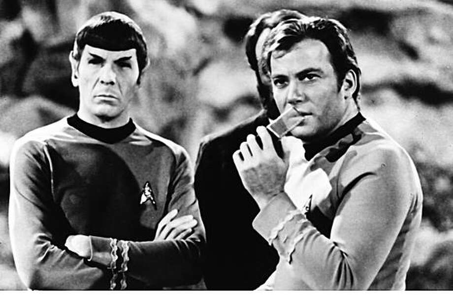 "LEONARD NIMOY AS SPOCK AND WILLIAM SHATNER AS CAPTAIN KIRK ON ""STAR TREK."""