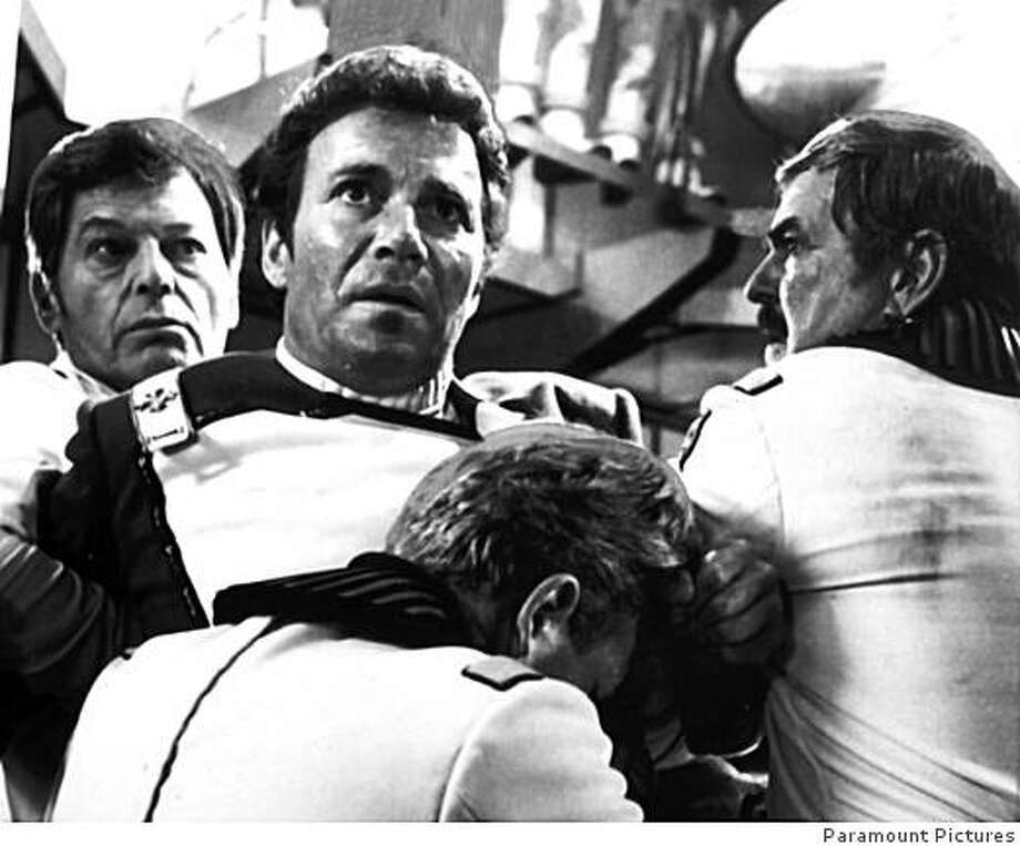 "William Shatner (center) as Admiral James T. Kirk, makes a horrifying discovery in the engine room of the Starship U.S.S. Enterprise, and is restrained by Deforest Kelley (left) and James Doohan in ""Star Trek: The Wrath of Khan"" Photo: Paramount Pictures"