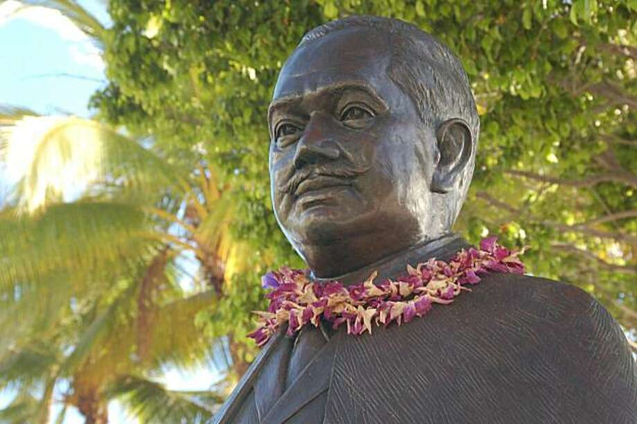 Orchid leis adorn the statue of Prince Kuhio at his namesake beach in Waikiki. Photo: Jeanne Cooper /Special To SFGate