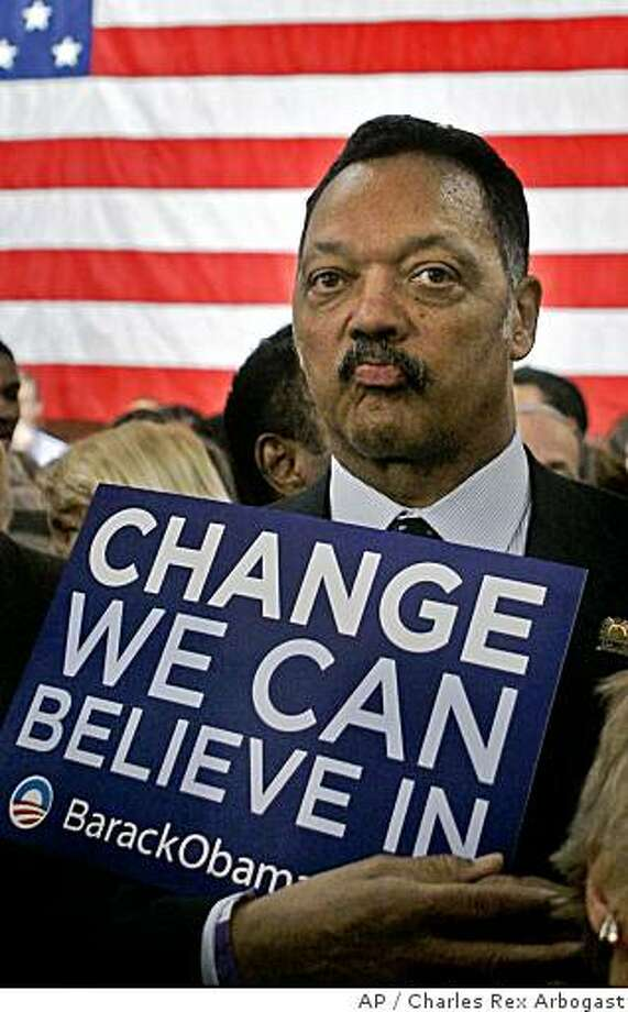 "** FILE ** In this Feb. 5, 2008 file photo, Rev. Jesse Jackson holds a campaign sign for  Sen. Barack Obama, D-Ill., in Chicago. Jackson said Wednesday, July 9, 2008 he's ""very sorry"" for comments he made about Barack Obama during what he thought was a private conversation with a reporter. (AP Photo/Charles Rex Arbogast) Photo: Charles Rex Arbogast, AP"