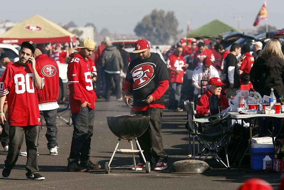 49ers fans tailgate before the team's game against the Saints at Candlestick Park. The San Francisco 49ers played the New Orleans Saints in the NFC Divisional playoff game at Candlestick Park in San Francisco, Calif., on Saturday, January 14, 2012. Photo: Brant Ward, The Chronicle
