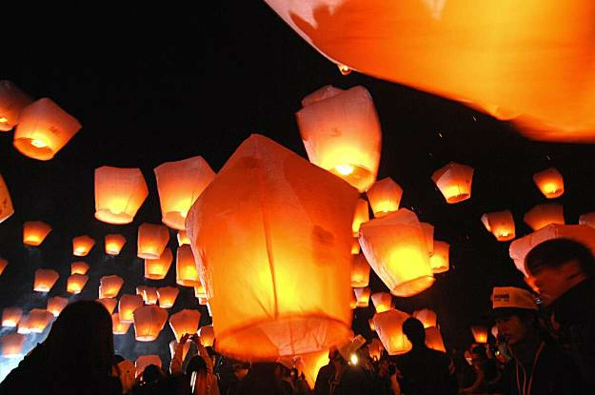 People release sky lanterns in Pinghsi, a township in Taiwan's northern Taipei county on February 28, 2010 to celebrate the annual Lantern Festival, which marks the end of the Lunar New Year festivities. The sky lantern is a symbol of peace, good wishes and safety.