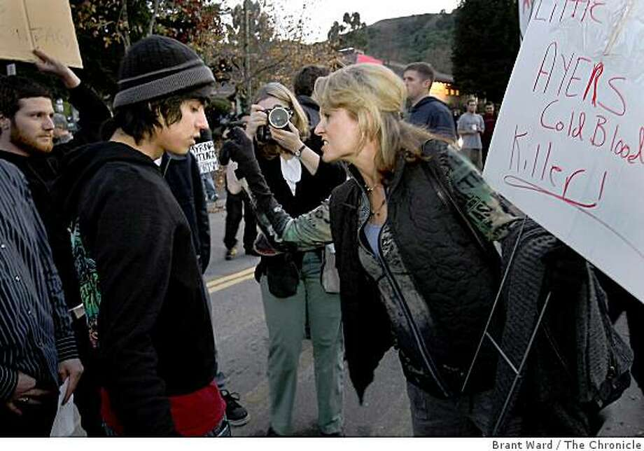 St. Mary's student Moises Gonzalez (left in hat) and protester Sherry Perussina of Danville disagreed on whether William Ayres should speak. William Ayres, the co-founder of the Weather Underground, spoke at St. Mary's College Wednesday January 28, 2009. Photo: Brant Ward, The Chronicle
