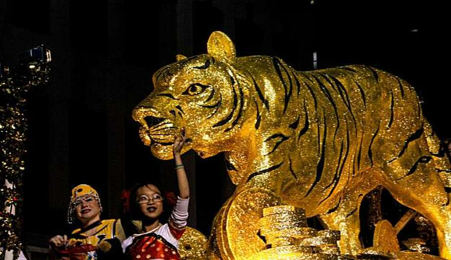 The Bank of the West float with a hugh tiger moves down Kearny Street during the Chinese New Year Parade on Saturday in San Francisco. Photo: Michael Macor, The Chronicle