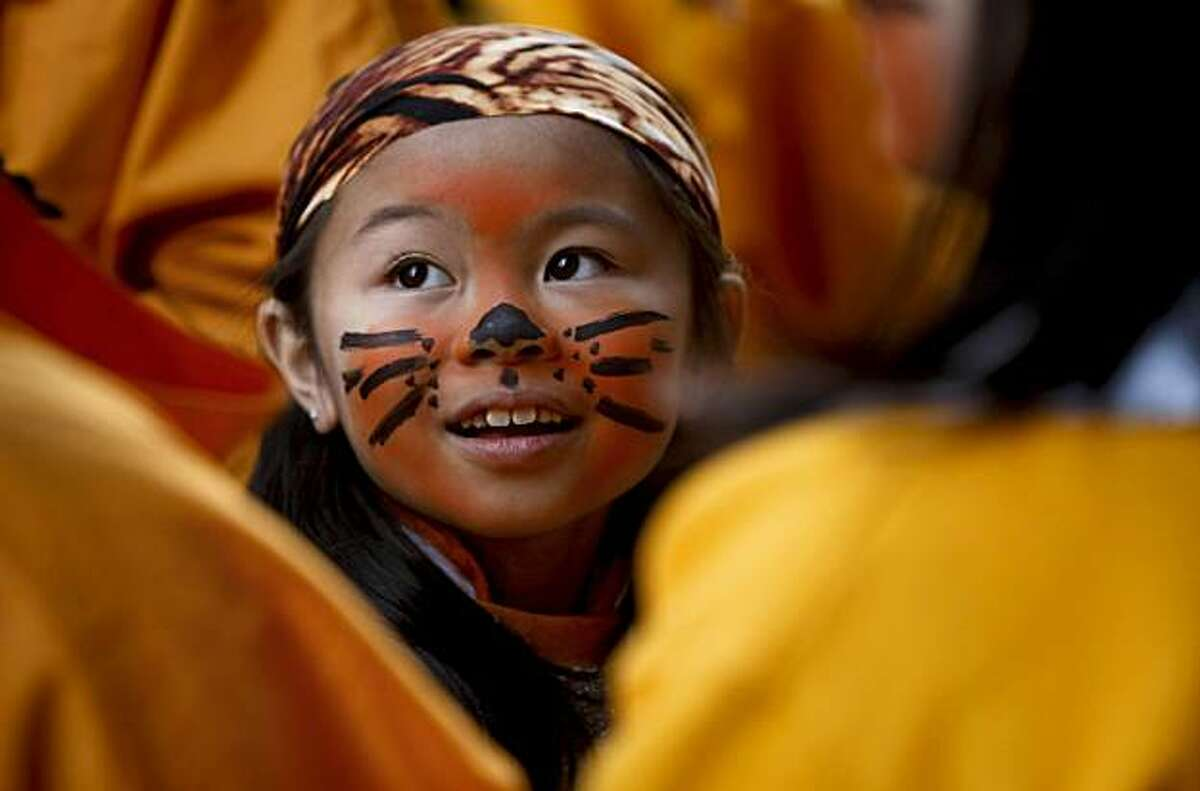 Kayla Hong, 7, part of the Tai Wong Kung Fu, waits for the start of San Francisco's Chinese New Year Parade on Saturday.