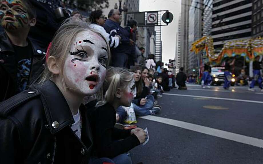 Fate Carroll, 8, of Corning watches along Market Street during the Chinese New Year Parade on Saturday in San Francisco. Photo: Michael Macor, The Chronicle