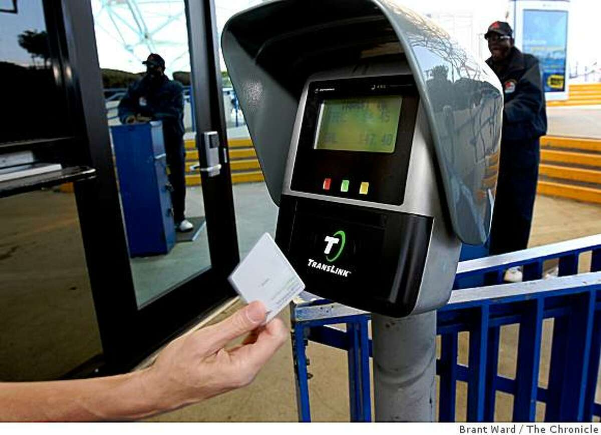 translink_289.JPG Translink card readers are conveniently located at ferry entrances so commuters can just zoom on board and not stand in ticket lines.Officials from Golden Gate Transit gave away some free translink cards to commuters Monday morning at the Larkspur Ferry terminal. When activated, the cards can be used like FasTrak to make regular commuting via ferry or bus simpler. {By Brant Ward/San Francisco Chronicle}9/17/07Ran on: 09-18-2007Golden Gate Transit official Mary Currie, above left, gives Robert Buron of San Rafael a free TransLink pass at the Larkspur ferry terminal Monday as part of a marketing push for the new regional fare card. TransLink will one day be able to be used on any Bay Area public transit system, but the Golden Gate and AC Transit agencies are the first to run TransLink systemwide. The two agencies are offering financial incentives to get people to use the fare card, which uses digital chips to deduct the correct fare using card readers, right. BART, Caltrain and Muni are scheduled to be added to the TransLink program next year. Other agencies will follow through 2010. More information on how the system works and where to buy cards is at www.translink.org.