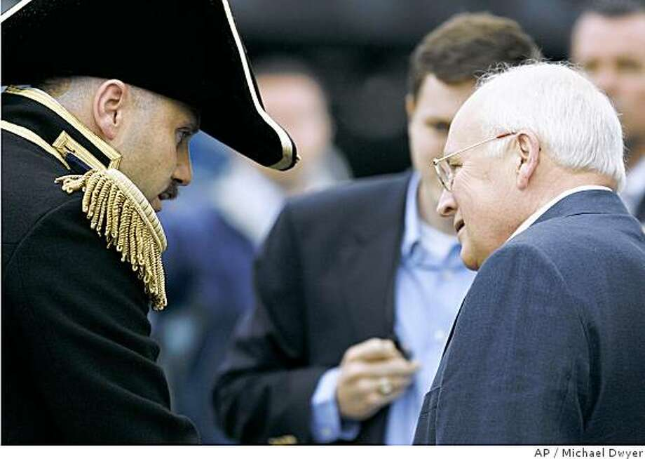 Vice President Dick Cheney, right, talks with Commanding Officer of the USS Constitution, William A. Bullard, III before departing on the ship's annual turnaround cruise in Boston Harbor, Friday, July 4, 2008, in Boston. (AP Photo/Michael Dwyer) Photo: Michael Dwyer, AP
