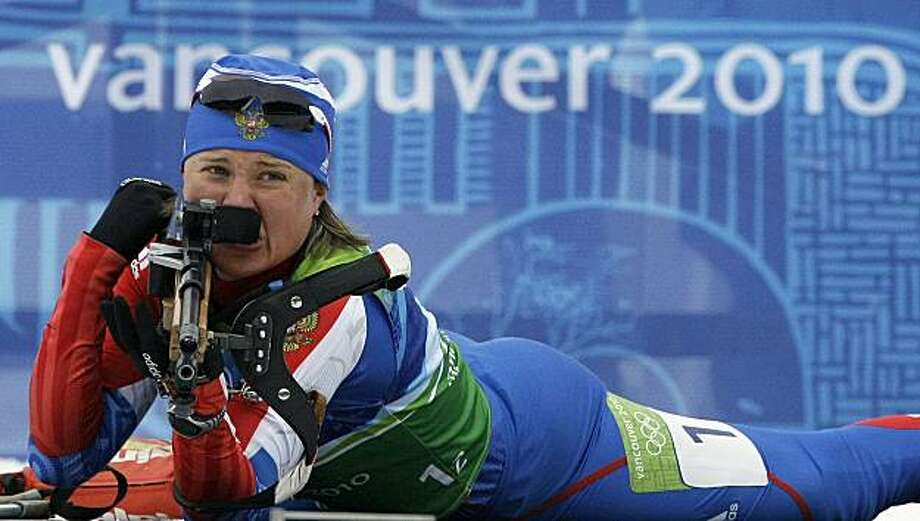 Anna Bogaliy-Titovets of Russia at the shooting range giving Russia the gold medal in the women's 4x6 km biathlon relay at the Vancouver 2010 Olympics in Whistler, British Columbia, Tuesday, Feb. 23, 2010. Photo: Jin-man Lee, AP