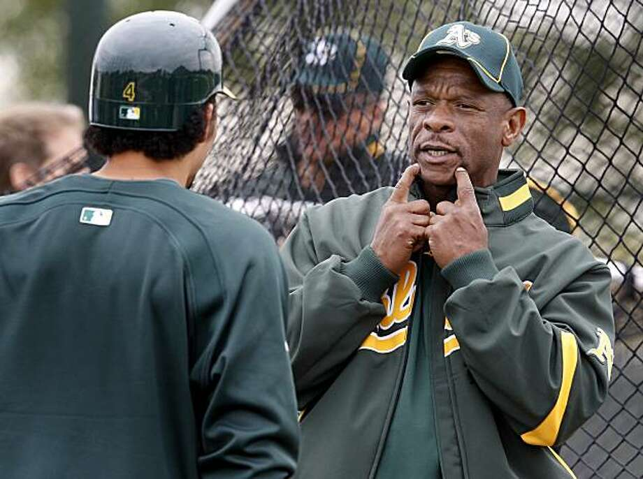 Former Oakland A's star and Hall of Famer Rickey Henderson talked to Coco Crisp around the batting cage Saturday February 27, 2010. Annual spring training action with the San Francisco Giants and Oakland Athletics from Scottsdale and Phoenix, Arizona. Photo: Brant Ward, The Chronicle