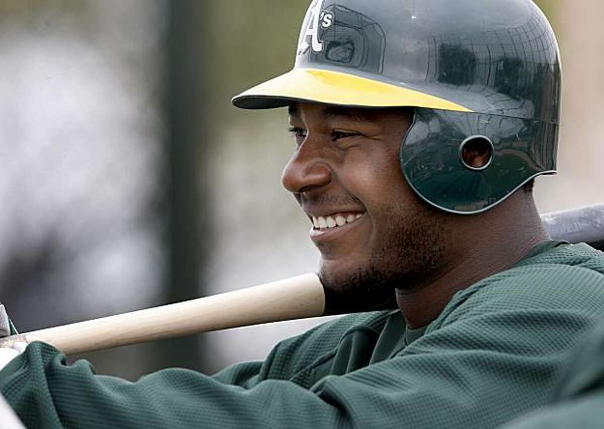 The Oakland A's Chris Carter watches hitting practice Feb. 27 at spring training.