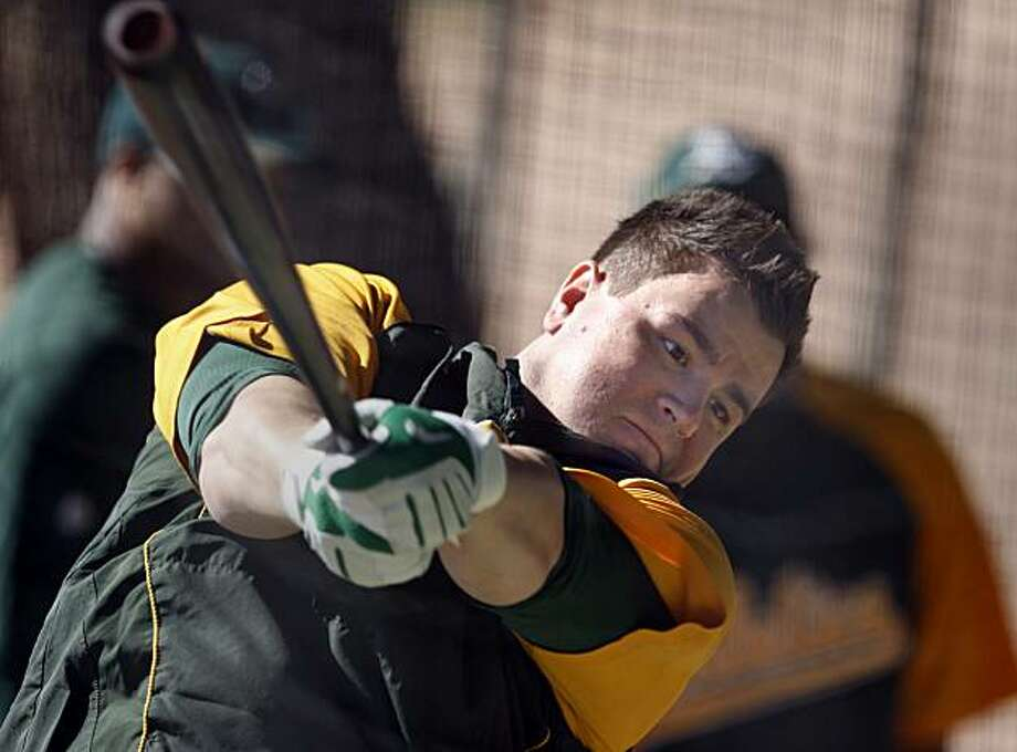 The Oakland Athletics Jack Cust lets one fly during his first batting cage workouts of the spring Thursday February 25, 2010. Scenes from the San Francisco Giants and Oakland Athletics spring training campaigns of 2010 in Scottsdale and Phoenix, Arizona. Photo: Brant Ward, The Chronicle