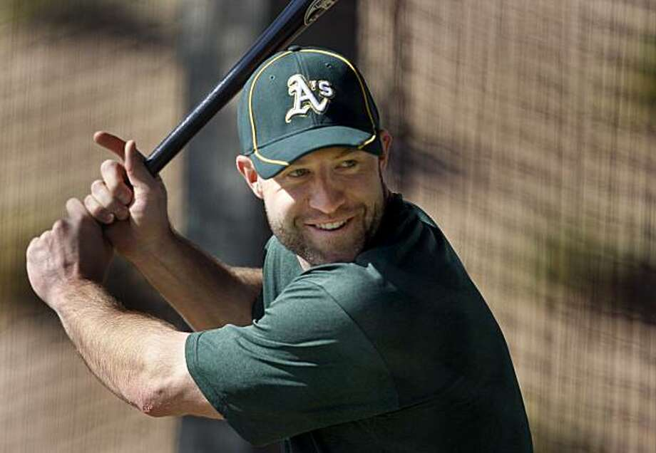 Kevin Kouzmanoff, the Oakland Athletics new third baseman, smiles as he takes his first batting practice Thursday February 25, 2010. Scenes from the San Francisco Giants and Oakland Athletics spring training campaigns of 2010 in Scottsdale and Phoenix, Arizona. Photo: Brant Ward, The Chronicle