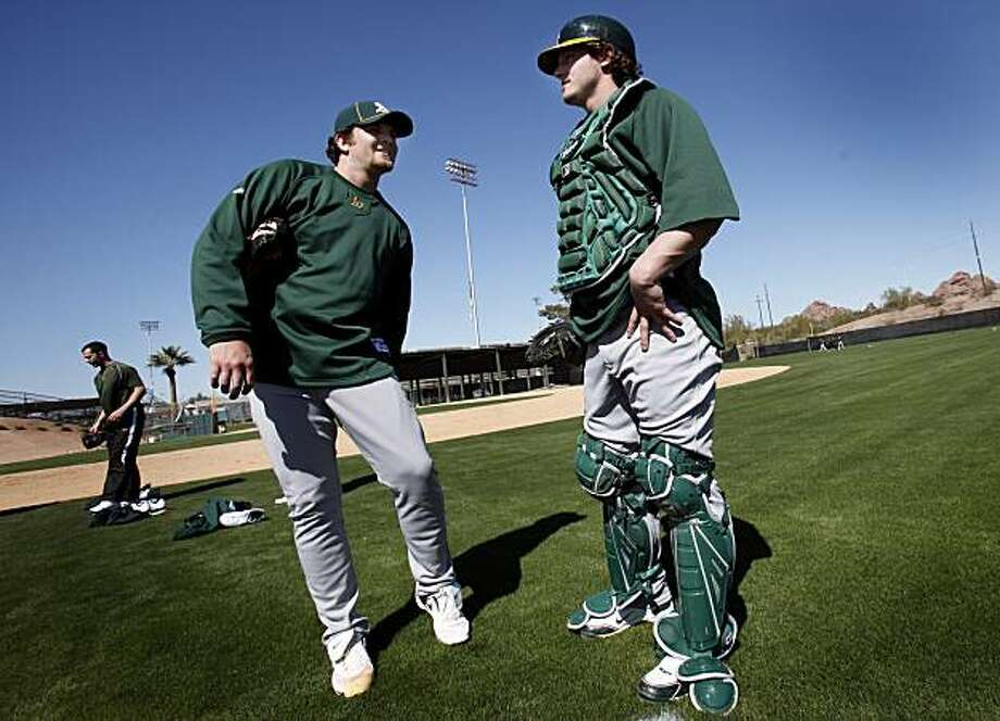 Oakland Athletics pitcher Bobby Cassevah (left) and catcher Josh Donaldson (right) grew up together and now find themselves at the A's spring training camp Tuesday February 23, 2010. Scenes from the San Francisco Giants and Oakland Athletics spring training campaigns of 2010 in Scottsdale and Phoenix, Arizona. Photo: Brant Ward, The Chronicle