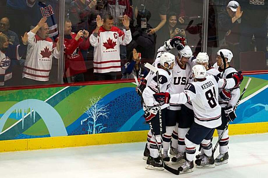 USA's Ryan Malone (12) celebrates with teammates after scoring a third period goal against Norway in a preliminary round hockey game at the 2010 Winter Olympics on Thursday, Feb. 18, 2010, in Vancouver.  The USA won the game 6-1. ( Smiley N. Pool / Houston Chronicle) Photo: Smiley N. Pool, Chronicle Olympic Bureau