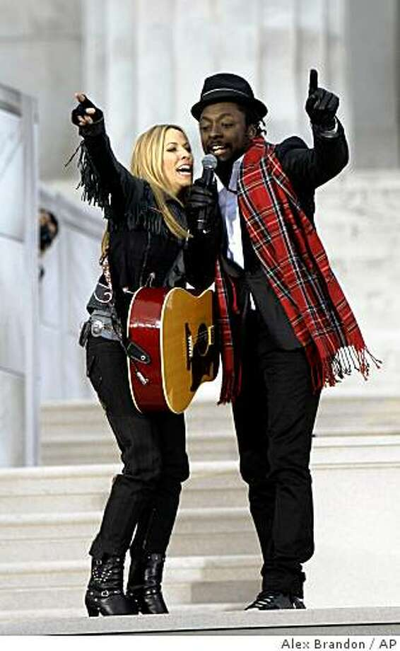 "Sheryl Crow and will.i.am perform during ""We Are One: Opening Inaugural Celebration at the Lincoln Memorial"" in Washington, Sunday, Jan. 18, 2009. Photo: Alex Brandon, AP"