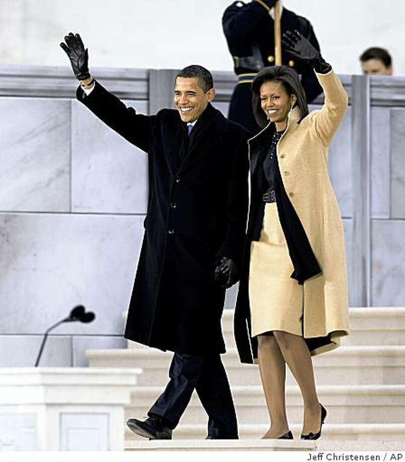"President-elect Barack Obama and his wife Michelle Obama, arrive at ""We Are One: Opening Inaugural Celebration at the Lincoln Memorial"" Sunday, Jan. 18, 2009, in Washington. Photo: Jeff Christensen, AP"