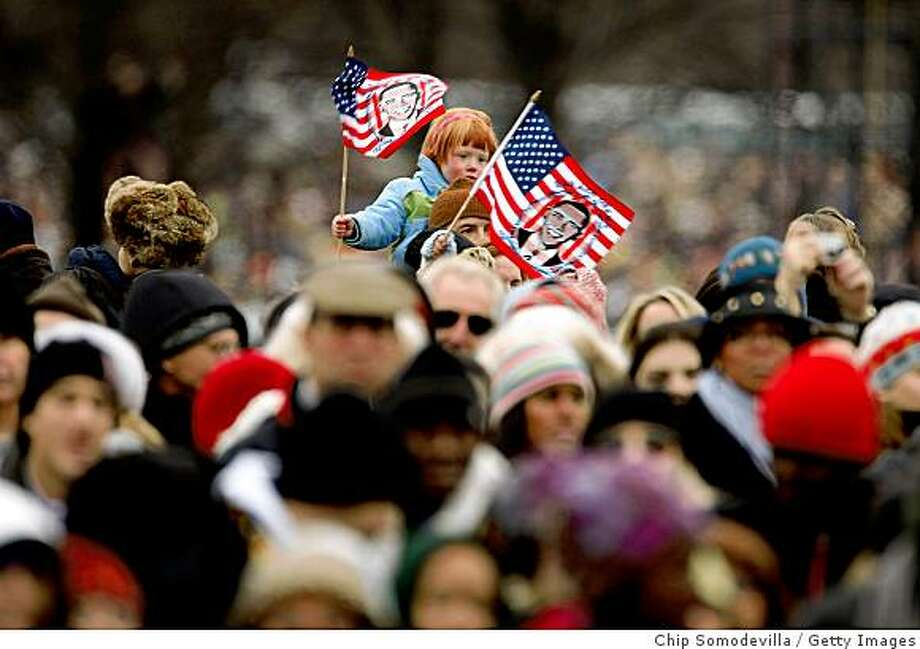 A child waves a U.S. flag with the face of President-elect Barack Obama printed on it during the 'We Are One: The Obama Inaugural Celebration At The Lincoln Memorial' on January 18, 2009 at the National Mall in Washington, DC. The event includes a diverse array of talent featuring both musical performances and historical readings and an appearance by U.S. President-elect Barack Obama. Photo: Chip Somodevilla, Getty Images