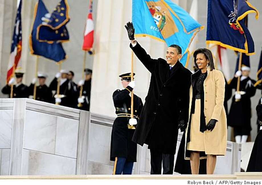 "US President-elect Barack Obama and his wife Michelle wave at the 'We Are One"" concert, one of the events of Obama's inauguration celebrations, at the Lincoln Memorial in Washington on January 18, 2009. Photo: Robyn Beck, AFP/Getty Images"