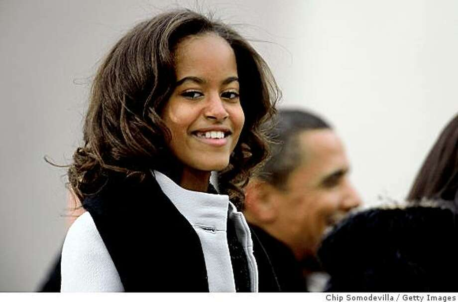 Malia Obama looks on during the 'We Are One: The Obama Inaugural Celebration At The Lincoln Memorial' on January 18, 2009 at the National Mall in Washington, DC. The event includes a diverse array of talent featuring both musical performances and historical readings and an appearance by U.S. President-elect Barack Obama. Photo: Chip Somodevilla, Getty Images