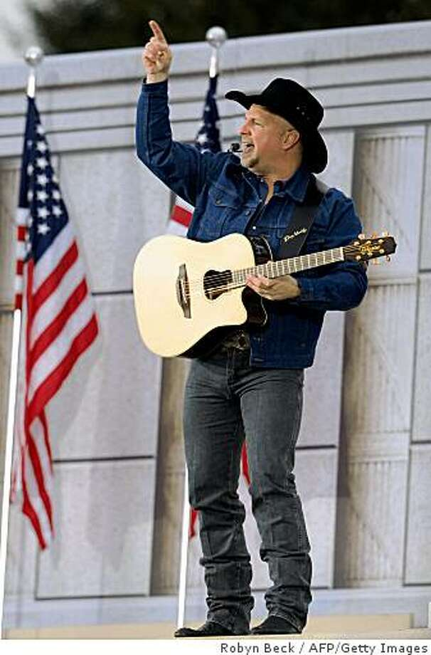 "Garth Brooks performs at the 'We Are One"" concert, one of the events of US president-elect Barack Obama's inauguration celebrations, at the Lincoln Memorial in Washington on January 18, 2009. Photo: Robyn Beck, AFP/Getty Images"
