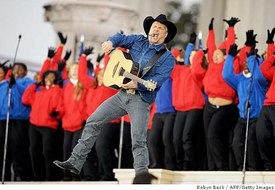 "Garth Brooks performs the song ""Shout"" by the Isley Brothers at the 'We Are One"" concert, one of the events of US president-elect Barack Obama's inauguration celebrations, at the Lincoln Memorial in Washington on January 18, 2009. Photo: Robyn Beck, AFP/Getty Images"