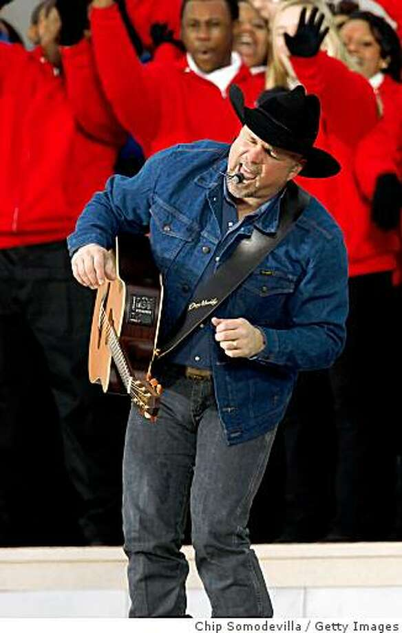 Musician Garth Brooks performs in front of the Lincoln Memorial during the 'We Are One: The Obama Inaugural Celebration At The Lincoln Memorial' on January 18, 2009 at the National Mall in Washington, DC. The event includes a diverse array of talent featuring both musical performances and historical readings and an appearance by U.S. President-elect Barack Obama. Photo: Chip Somodevilla, Getty Images