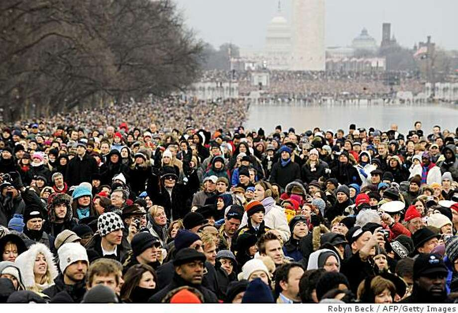 """People bundled up against the cold attend the 'We Are One"""" concert, one of the events of US president-elect Barack Obama's inauguration celebrations, at the Lincoln Memorial in Washington on January 18, 2009. Photo: Robyn Beck, AFP/Getty Images"""