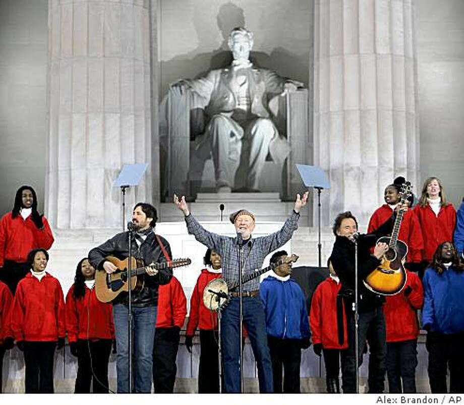 "Pete Seeger performs with his grandson Tao, left, and Bruce Spingsteen during ""We Are One: Opening Inaugural Celebration at the Lincoln Memorial"" in Washington, Sunday, Jan. 18, 2009. Photo: Alex Brandon, AP"