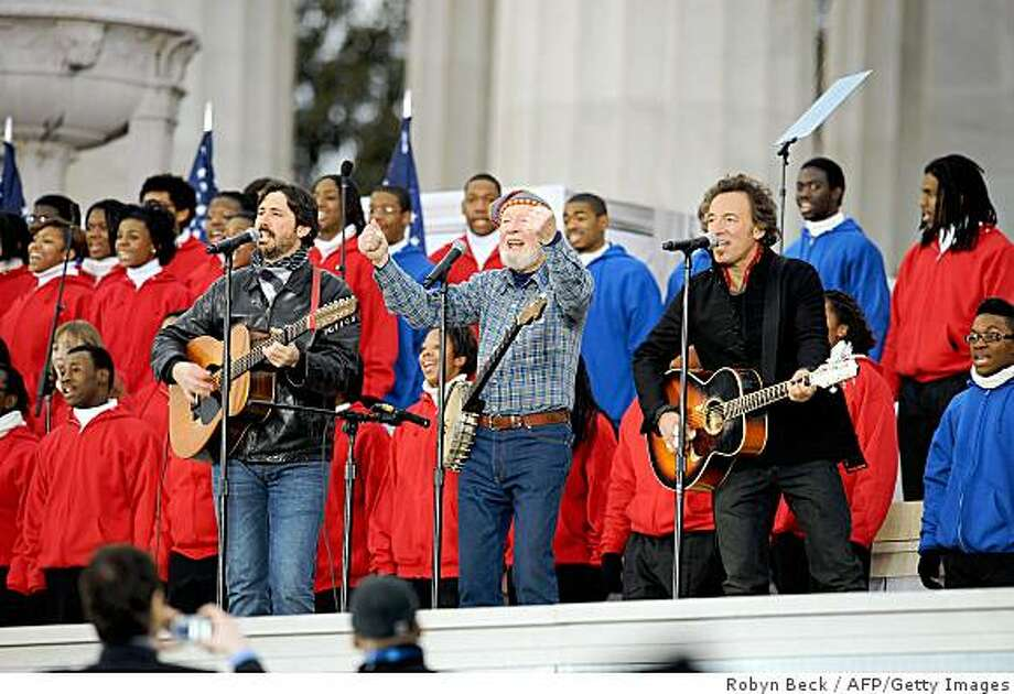 "Bruce Springsteen (R), Pete Seeger (C), and Seeger's grandson Tao Seeger (L) perform at the 'We Are One"" concert, one of the events of US president-elect Barack Obama's inauguration celebrations, at the Lincoln Memorial in Washington on January 18, 2009. Photo: Robyn Beck, AFP/Getty Images"