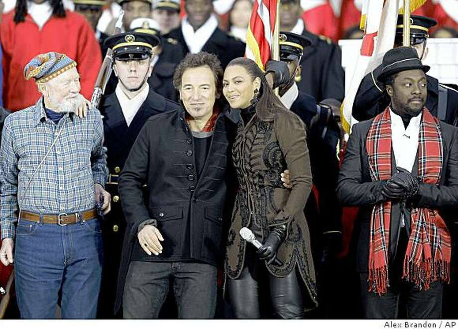 "Beyonce embraces Bruc e Springsteen as will.i.am, right, and Pete Seeger, left, look on after performing during ""We Are One: Opening Inaugural Celebration at the Lincoln Memorial"" in Washington, Sunday, Jan. 18, 2009. Photo: Alex Brandon, AP"