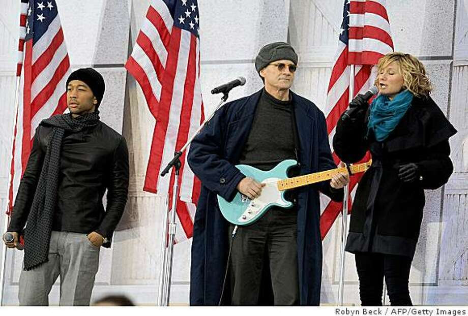 "Jennifer Nettles (R), John Legend (L) and James Taylor (C) perform at the 'We Are One"" concert, one of the events of US president-elect Barack Obama's inauguration celebrations, at the Lincoln Memorial in Washington on January 18, 2009. Photo: Robyn Beck, AFP/Getty Images"