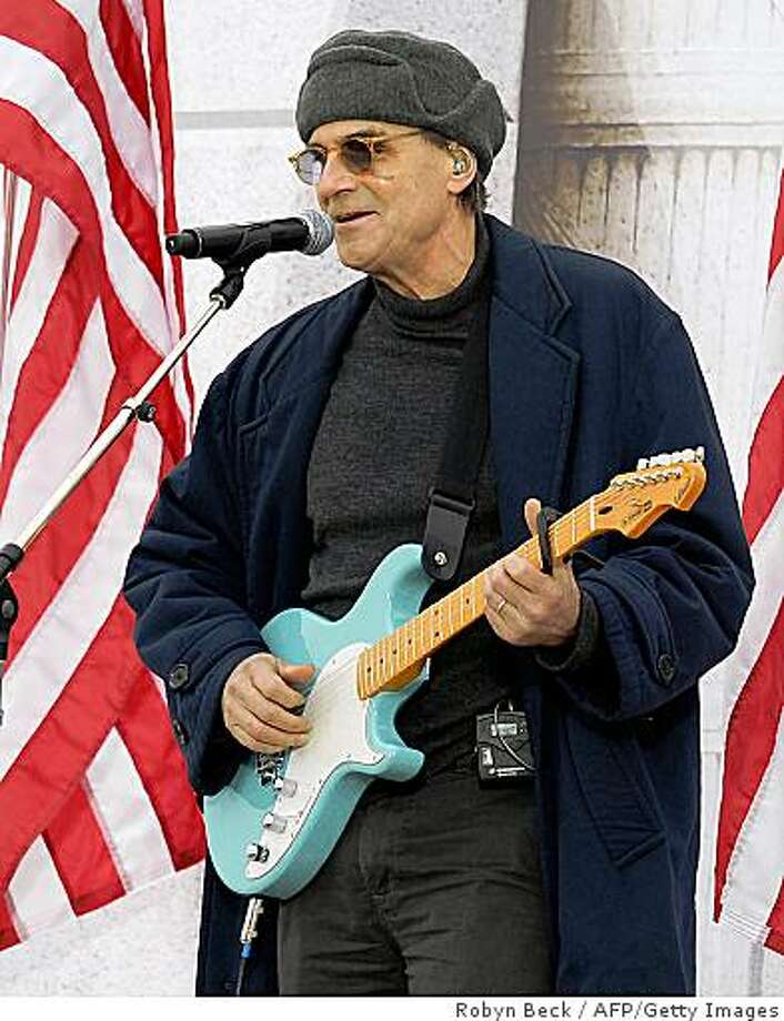 "James Taylor performs at the 'We Are One"" concert, one of the events of US president-elect Barack Obama's inauguration celebrations, at the Lincoln Memorial in Washington on January 18, 2009. Photo: Robyn Beck, AFP/Getty Images"