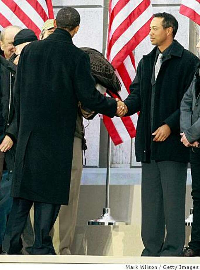 "U.S. President-elect Barack Obama (L) shakes hands with golfer Tiger Woods (R) during the 'We Are One: The Obama Inaugural Celebration at The Lincoln Memorial"" January 18, 2009 in Washington, DC. The event includes a diverse array of talent featuring both musical performances and historical readings and an appearance by U.S. President-elect Barack Obama. Photo: Mark Wilson, Getty Images"